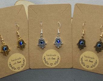 eye Singularity earrings ~ handstamped vintage brass with ring hand