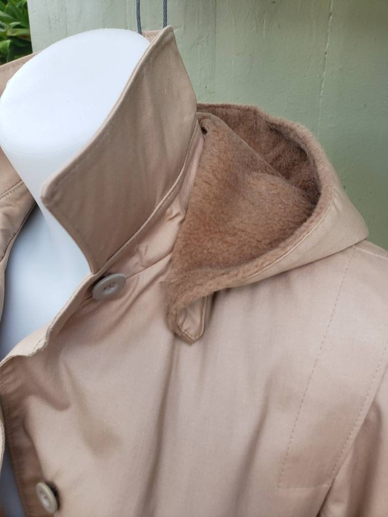 Vintage London Fog Womens trench raincoat with lining and hood.