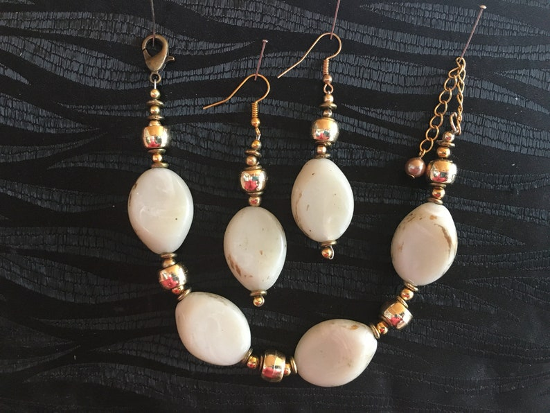 Cream and gold bracelet and earrings