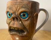 Uglymug - each sculpture is a hand made one of a kind coffee Mug.