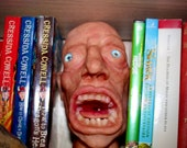 Scary face, book-between book shelf accessory