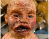 Old baby Scary Doll , mixed media work in progress more pictures to come
