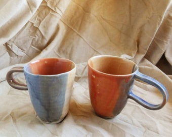 Two colorfull coffee or tea mugs cups handmade