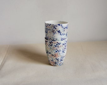 Two porcelain espresso or tea cups with marble and terazzo pattern