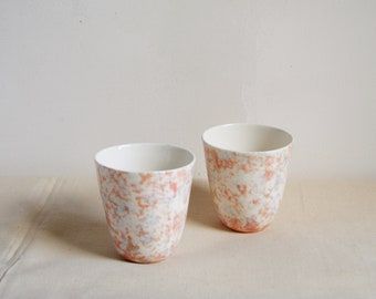 Two porcelain coffee or tea cups with terazzo / marble pattern