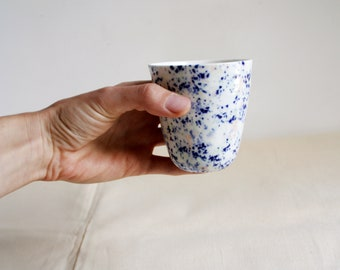 Porcelain coffee or tea cup with terazzo / marble pattern