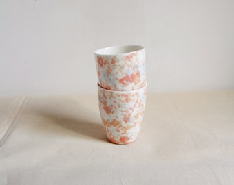 Two porcelain espresso or tea cups with marble / terazzo