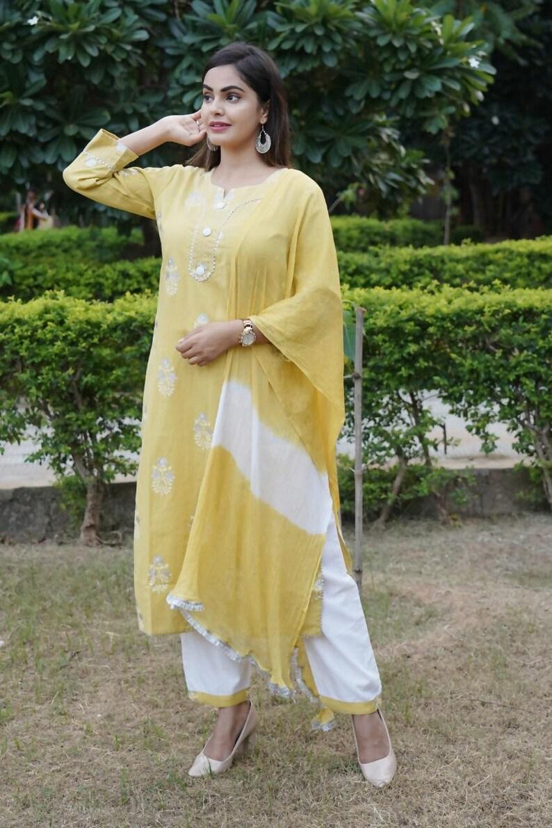 Work on Kurti Beautiful cotton flex Fabric kurti with Pant and nazmin duppatta Cotton Flex Kurti And Pant And Yellow Color Nazmin Dupataa