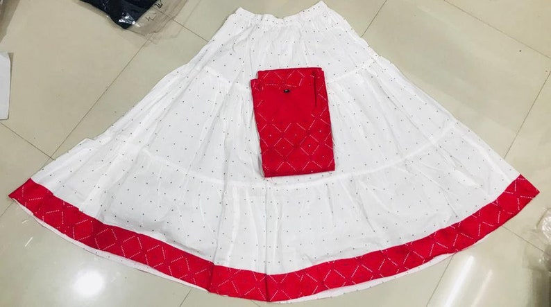 Reyon Kurti With Mirror WorkWith Full Flair Cotton Skirt Gift urself these trendy n comfortable stylish look this designer Kurti With Skirt