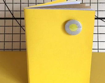 Yellow notebook with badge