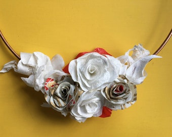 Wreath of roses made from recycled plastic bags.