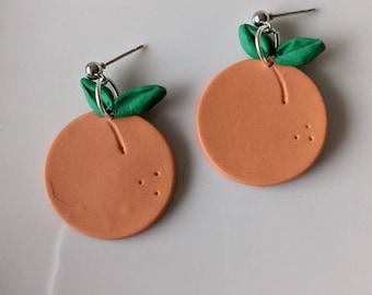 Peach earrings teardrop painted enamel lightweight 2 38 long dangle earrings light coral peach color