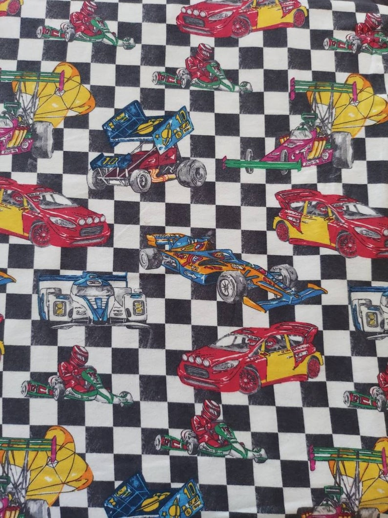 Racecars on black and white Checkered Flannel assorted image 0