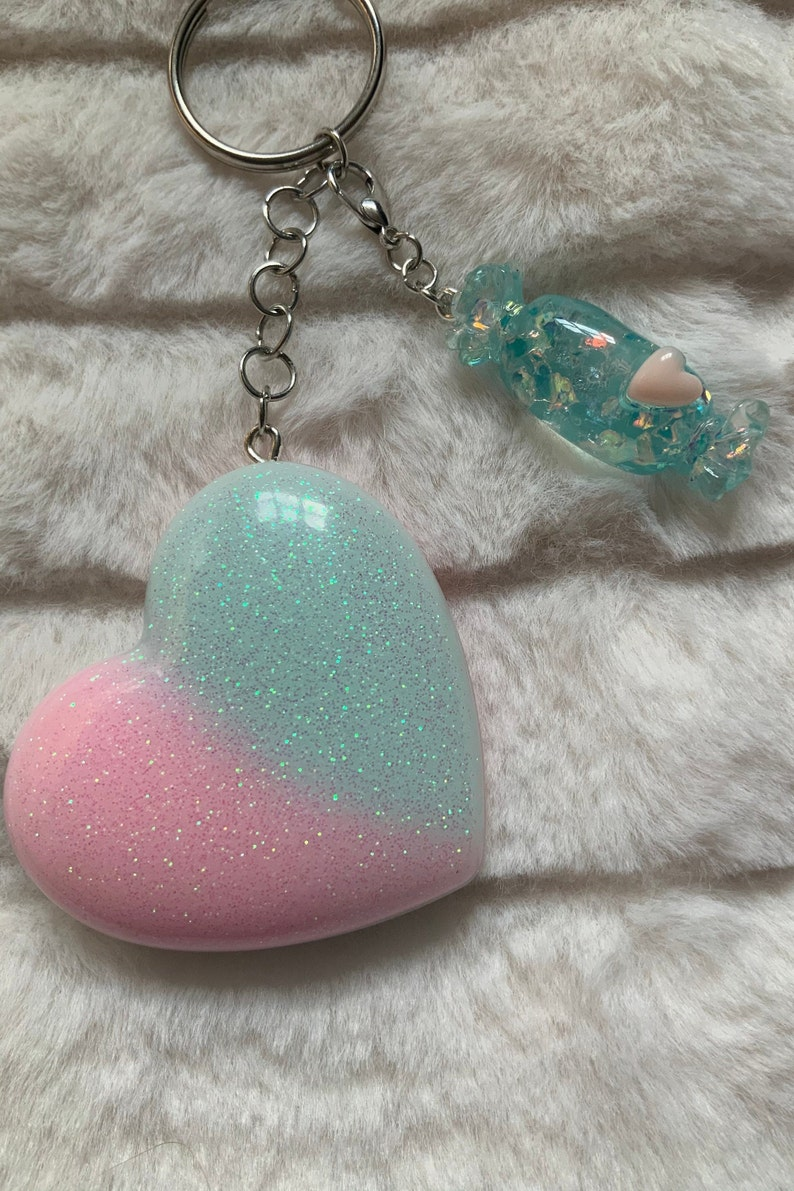 Pastel pink and blue iridescent glitter heart shaped keyring