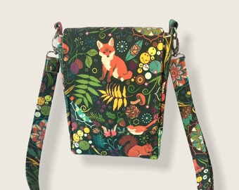 """Cute fox print crossbody bag built for a day on the town! Featuring an adjustable strap, two pockets + main compartment, 8.5""""x6""""x3""""."""