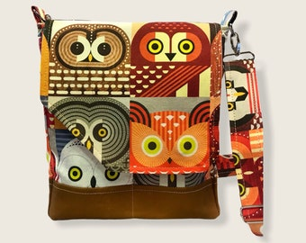 Owl print bag made of artisan fabric and hand waxed canvas! Adjustable strap, five pockets & roomy interior, magnetic flap closure.
