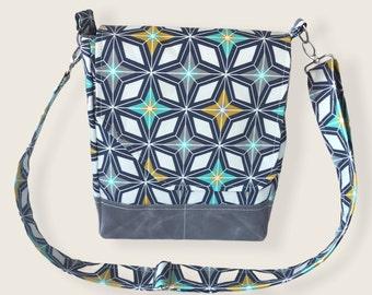 Mid-century modern geometric print crossbody bag, retro style purse. Adjustable strap, five pockets & roomy interior, magnetic flap closure.