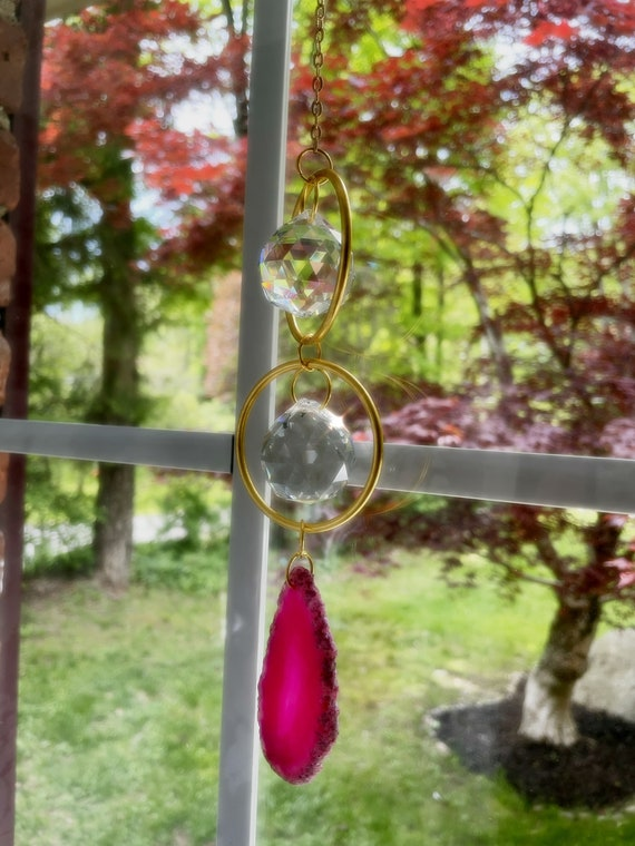 Pink agate sun catcher infused with reiki energy