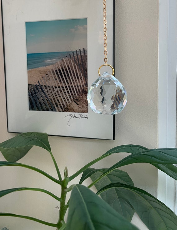 One large crystal prism with chain