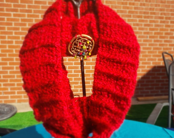 Infinity scarf with jeweled medallion