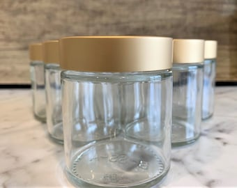 4oz Clear Glass Jar with Brushed Gold lid for Creams, skincare and essential oils.  Our Gold Lid adds a touch of elegance to any product!