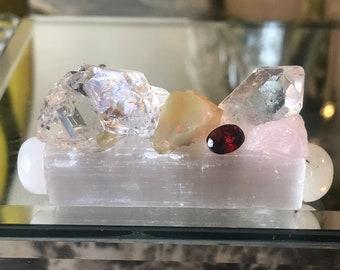Glowing feminine energy crystal cluster