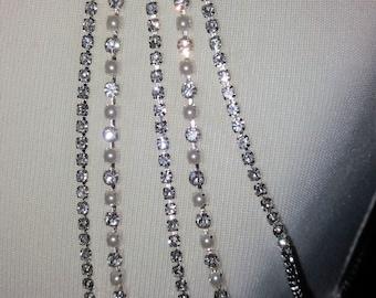 "Bridal shoulder jewellery epaulettes. Clear diamante, AB diamante or Diamante & pearls. 5 rows 14.16,18,20,22"" 1 pair. Shoulder chains."