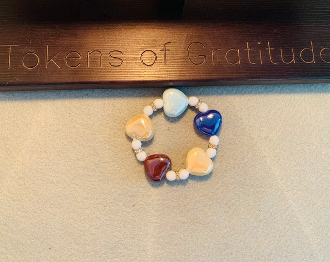 Multicolored beaded stretch bracelet with heart beads