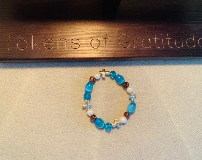 Turquoise color cross beaded bracelet