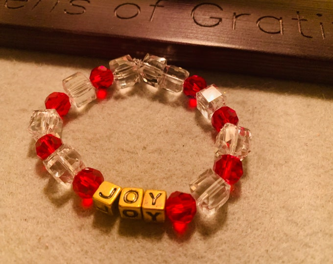 Holiday colored Beaded Stretch Bracelet with JOY in gold beads