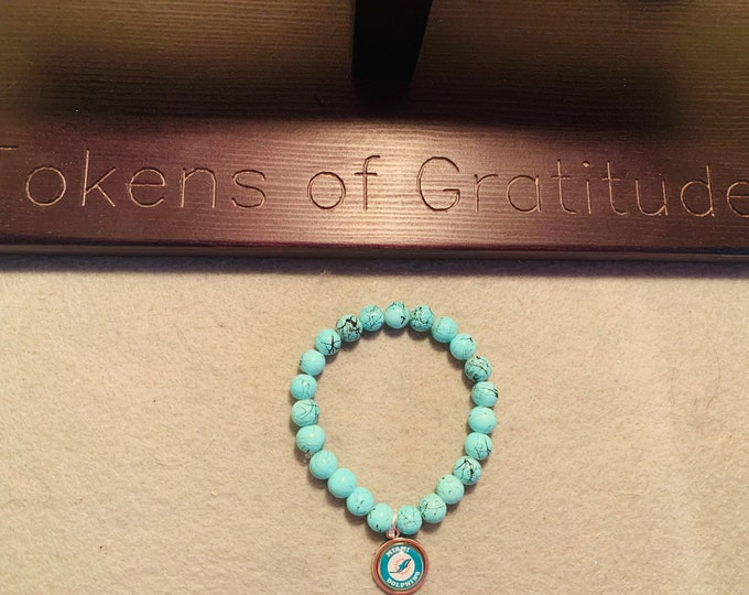 Turquoise football Beaded Stretch Bracelet with charm (pictured)