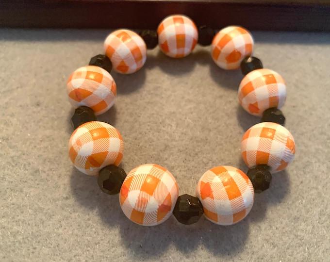 Halloween Orange and White Plaid beaded stretch bracelet
