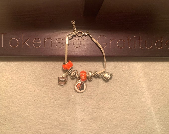 Orange and Brown Charm Bracelet/ (Browns theme- customer chooses charm) on beige leather cord.