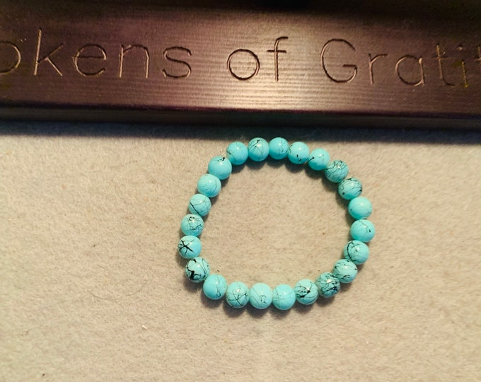 Turquoise color square beaded stretch bracelet