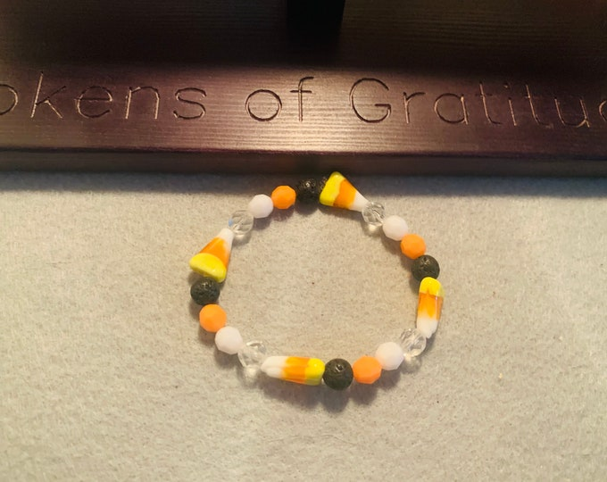Candy Corn/ Halloween beaded stretch bracelet with candy corn beads