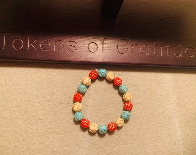 Turquoise, red and cream color square beaded stretch bracelet