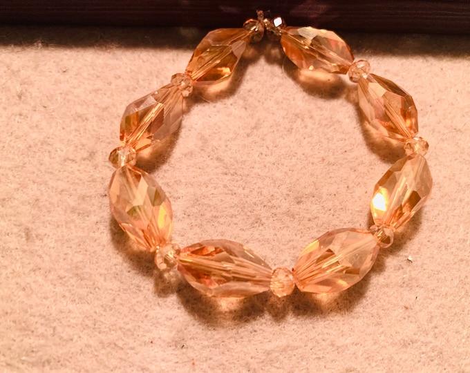 Beige beaded stretch bracelet with sparkly beads
