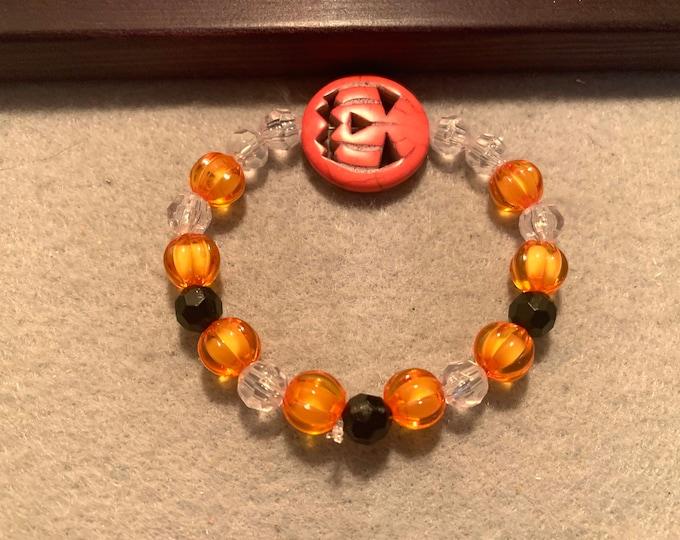 Jack- O -Lantern /Halloween beaded pumpkins stretch bracelet