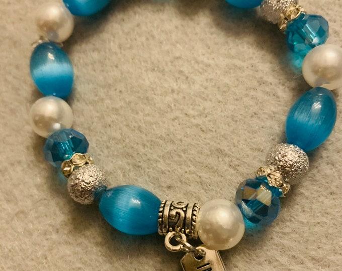 """Blue and white beaded """"Imagine"""" charm bracelet"""