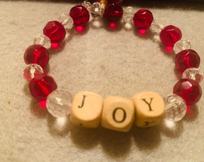 Holiday colored Beaded Stretch Bracelet with JOY in wooden beads and a bulb / ornament charm