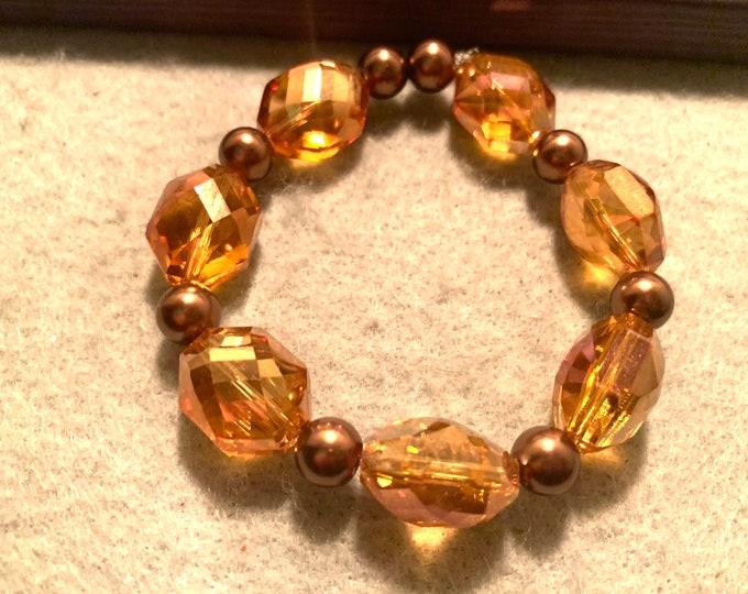 Brown/rootbeer tinted color beaded stretch bracelet