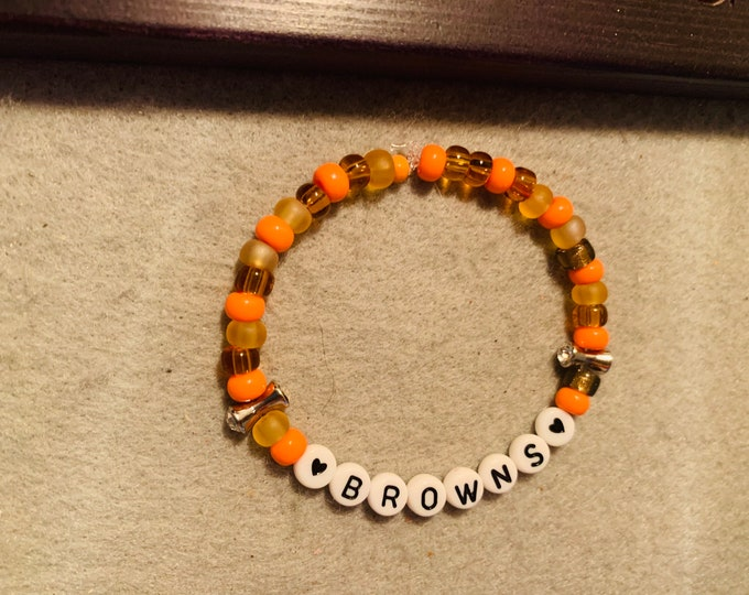 Brown and Orange Beaded Stretch Bracelet with two silver dog bone beads