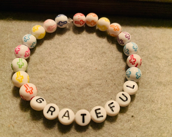 Grateful beaded stretch bracelet with tiny cross beads