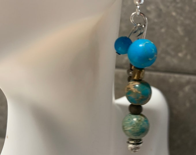 Turquoise (color) and brown beaded earrings