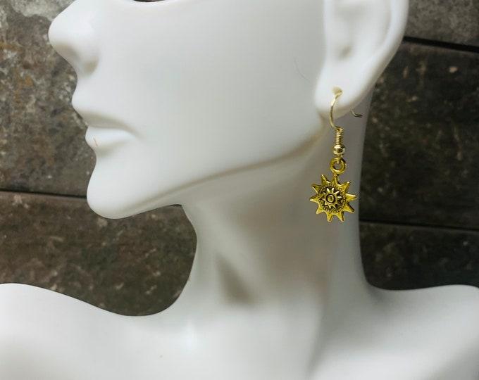 Gold colored sunshine earrings