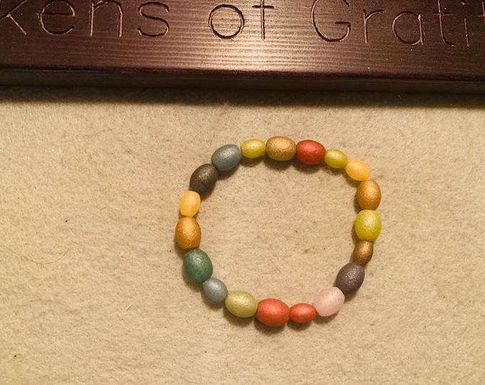 Multicolored glass beaded stretch bracelet (oval shaped beads)