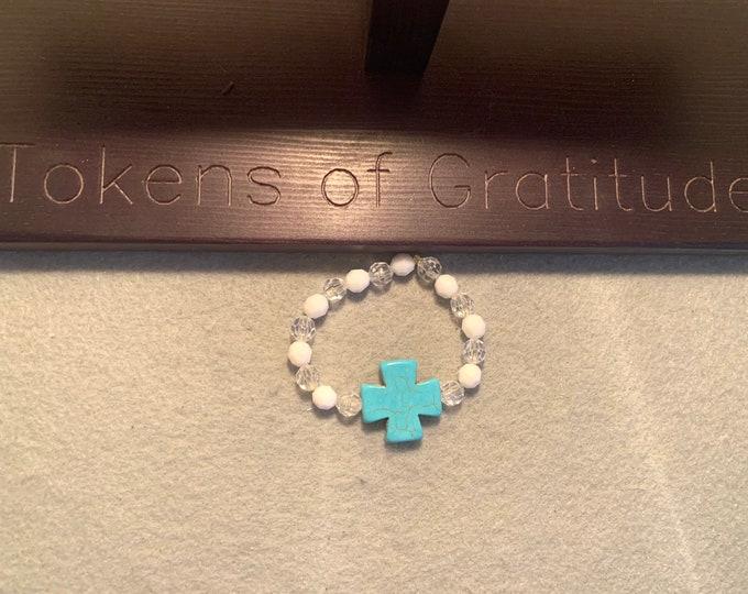 Turquoise colored cross (medium sized cross) beaded stretch bracelet
