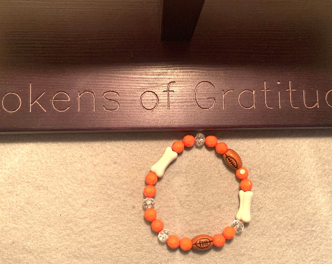 Brown and Orange Stretch Bracelet with football beads and white bead beads