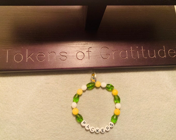 Green/Yellow/ White Beaded Stretch Bracelet with charm (pictured)