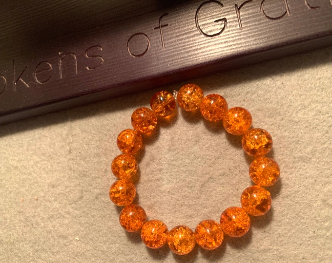 Sparkly orange beaded stretch bracelet